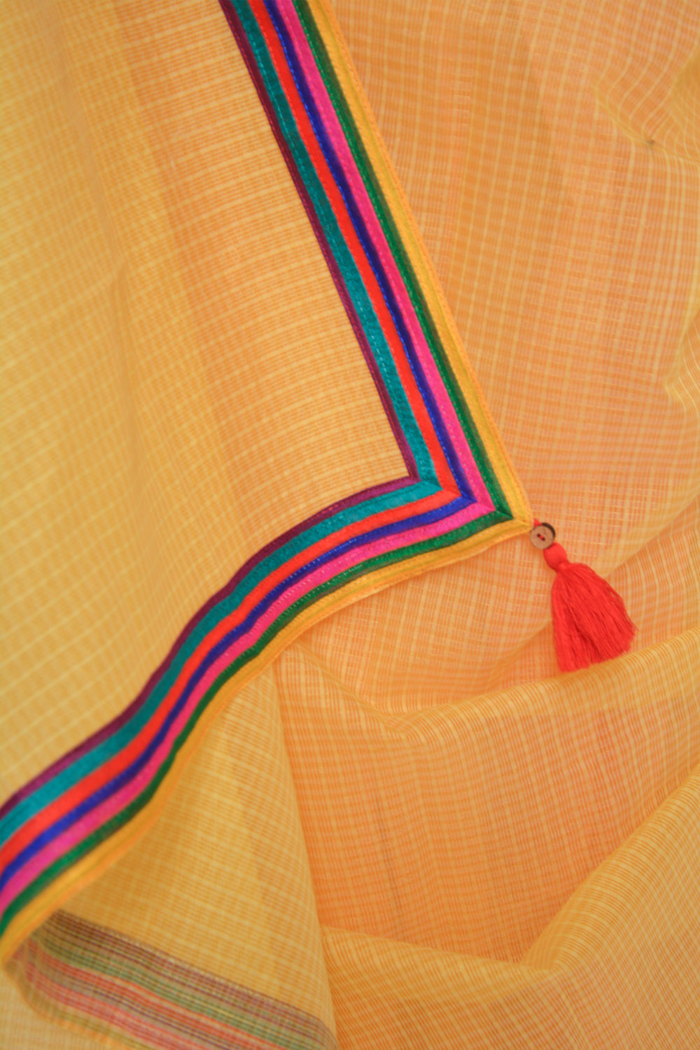 Yellow and orange half and half Kota doria saree with multicolour border