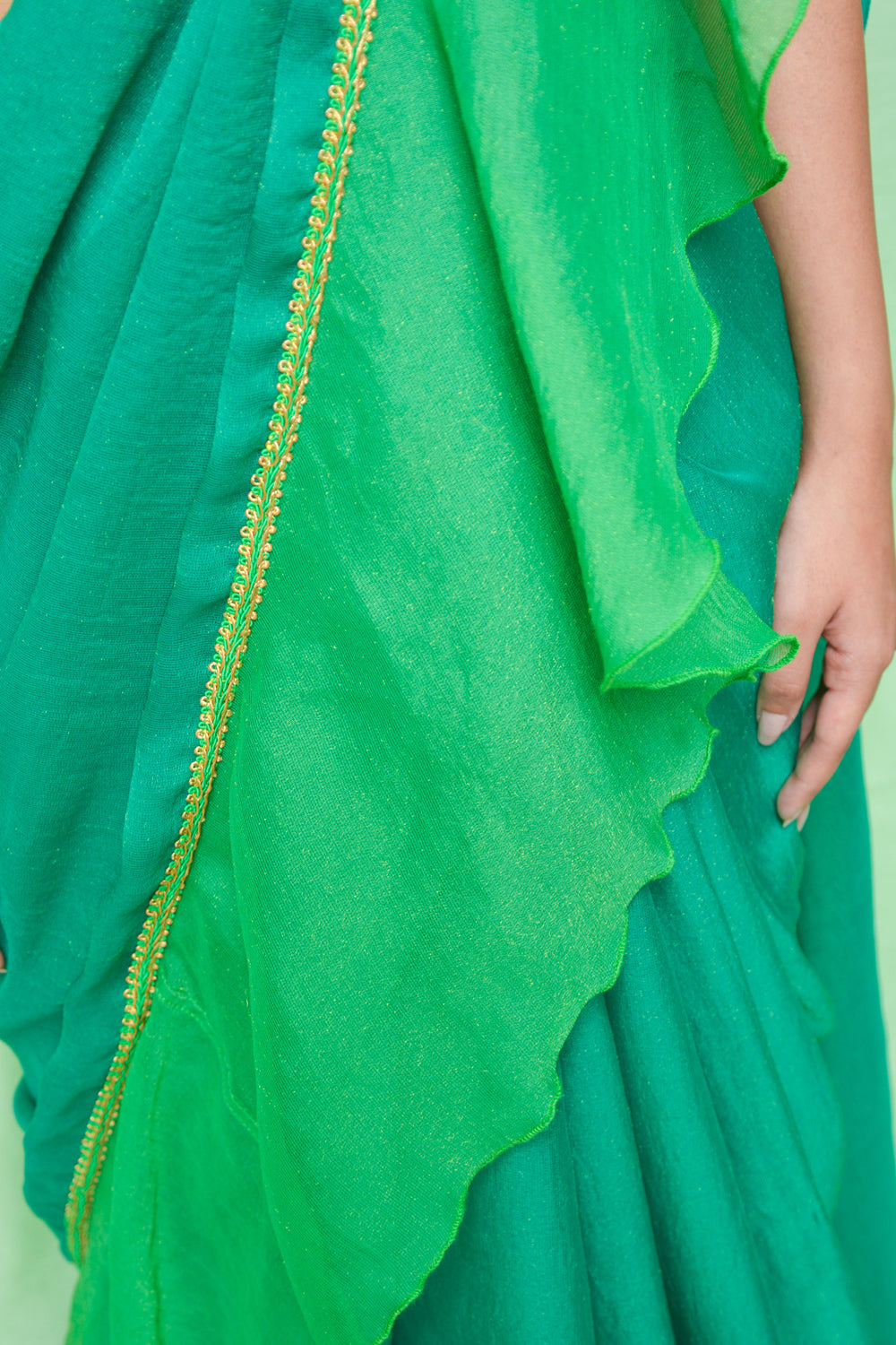 Green shimmer georgette ruffle saree with green-gold border