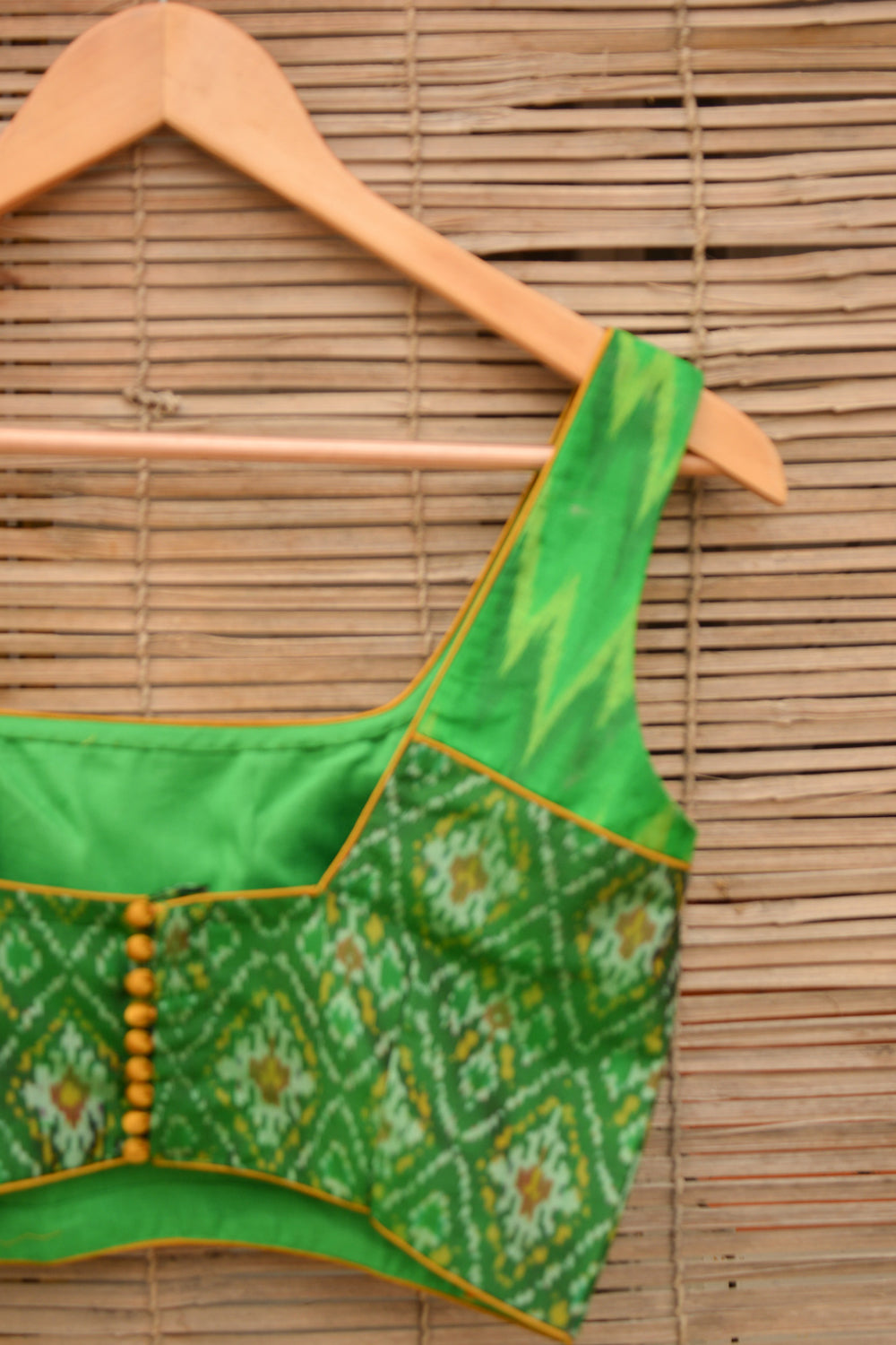 Emerald green Ikat sleeveless two fabric blouse - House of Blouse