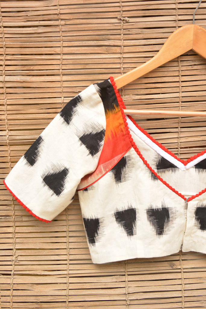 White and black Ikat cotton armband blouse with red pom pom detailing - House of Blouse