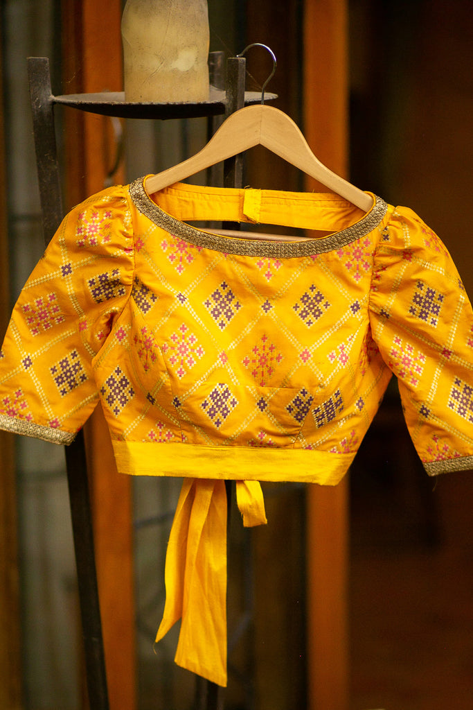 Yellow multicolour brocade boatneck puff sleeves blouse with tie back - House of Blouse