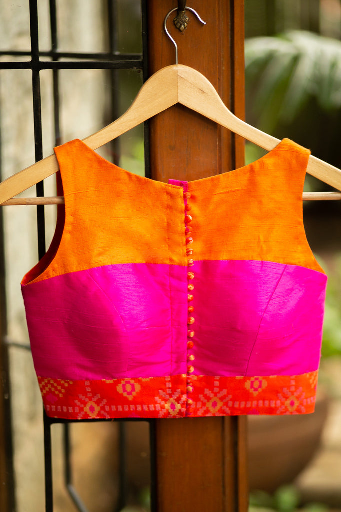 Orange and pink colour block raw silk sleeveless blouse with brocade border - House of Blouse