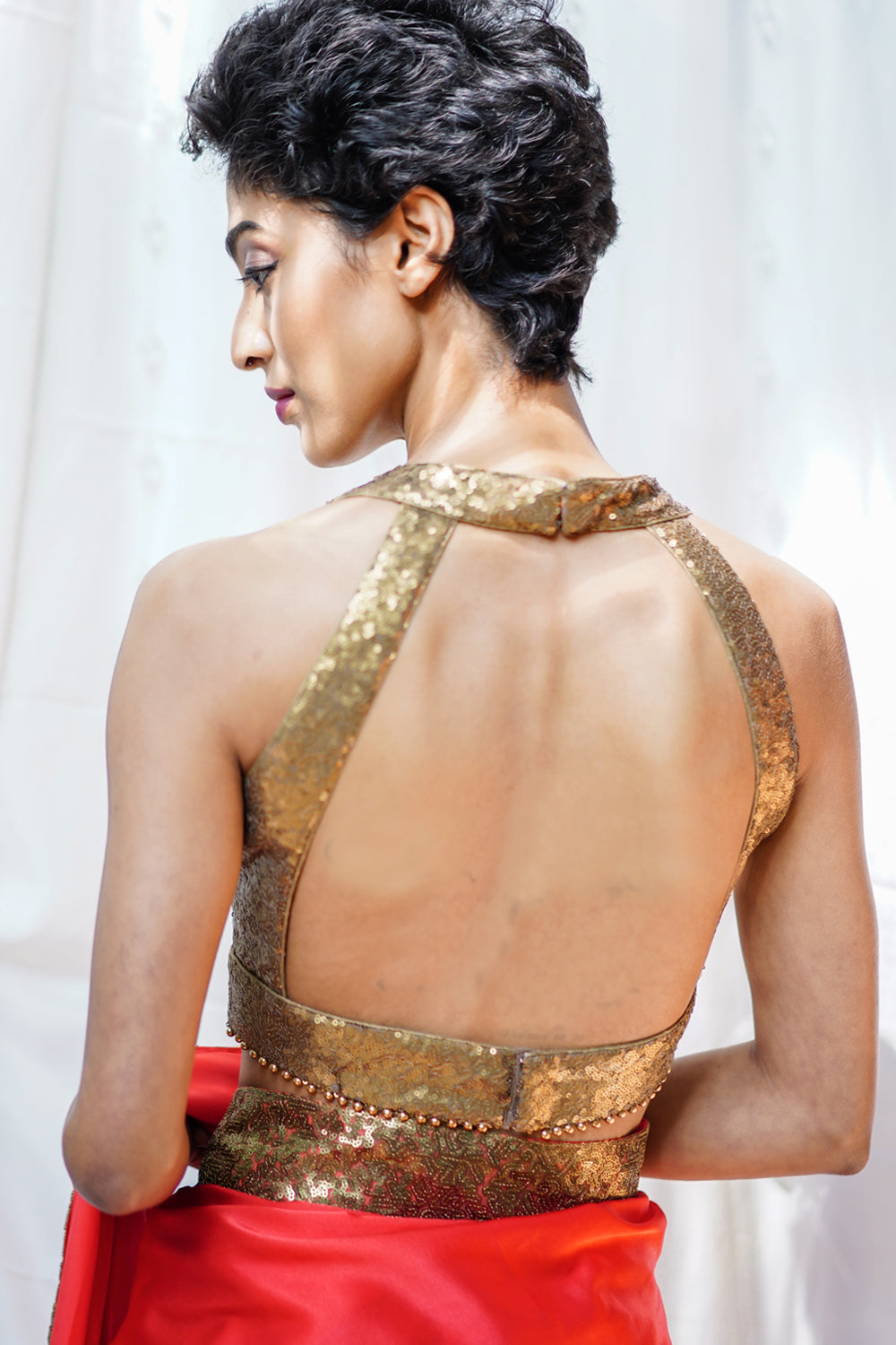 Gold sequin U neck sleeveless blouse with beads detailing. - House of Blouse