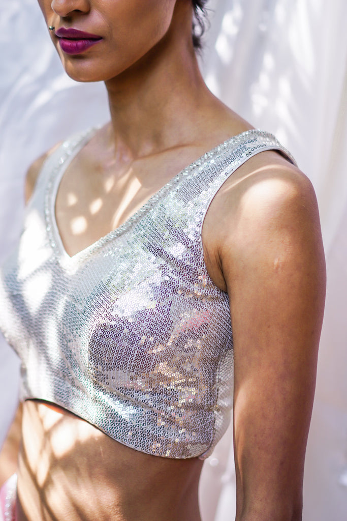 Silver sequin V neck sleeveless blouse with beads detailing. - House of Blouse