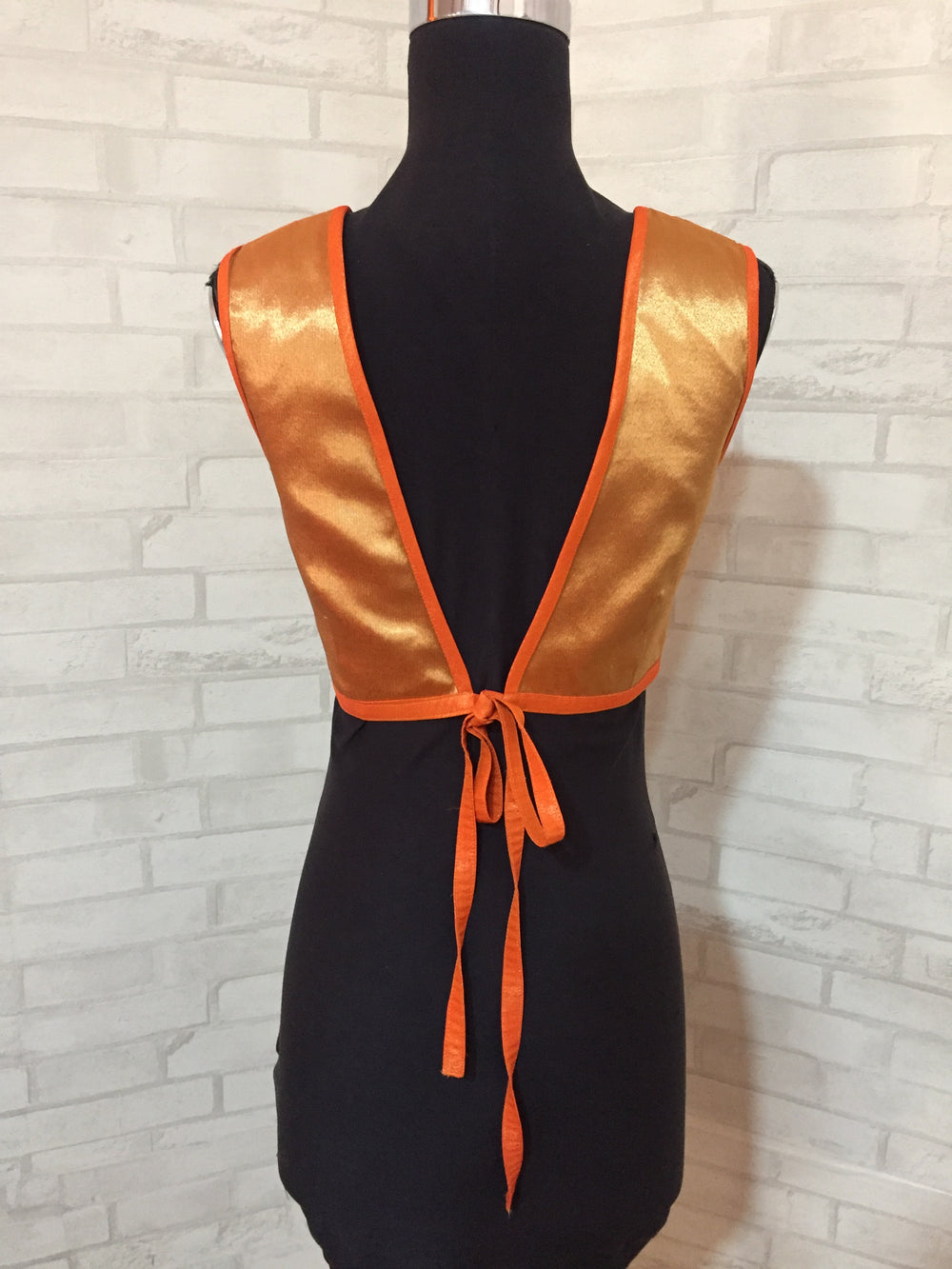 Orange tissue sleeveless blouse with embellished yoke and tie back - House of Blouse