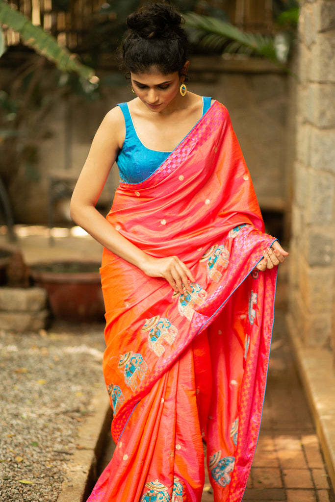 Pinkish orange semi silk saree with gold buttis and embroidered elephants and blue piping - House of Blouse