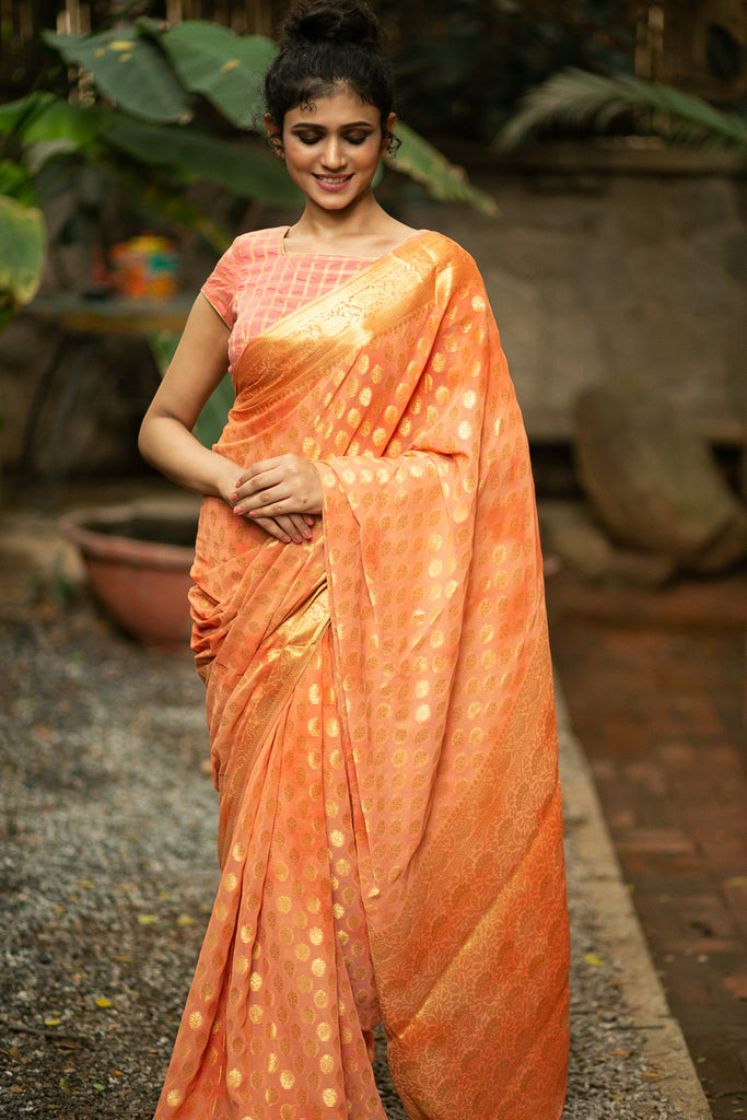 Pale orange Banarasi chiffon saree with zari buttis and zari border - House of Blouse
