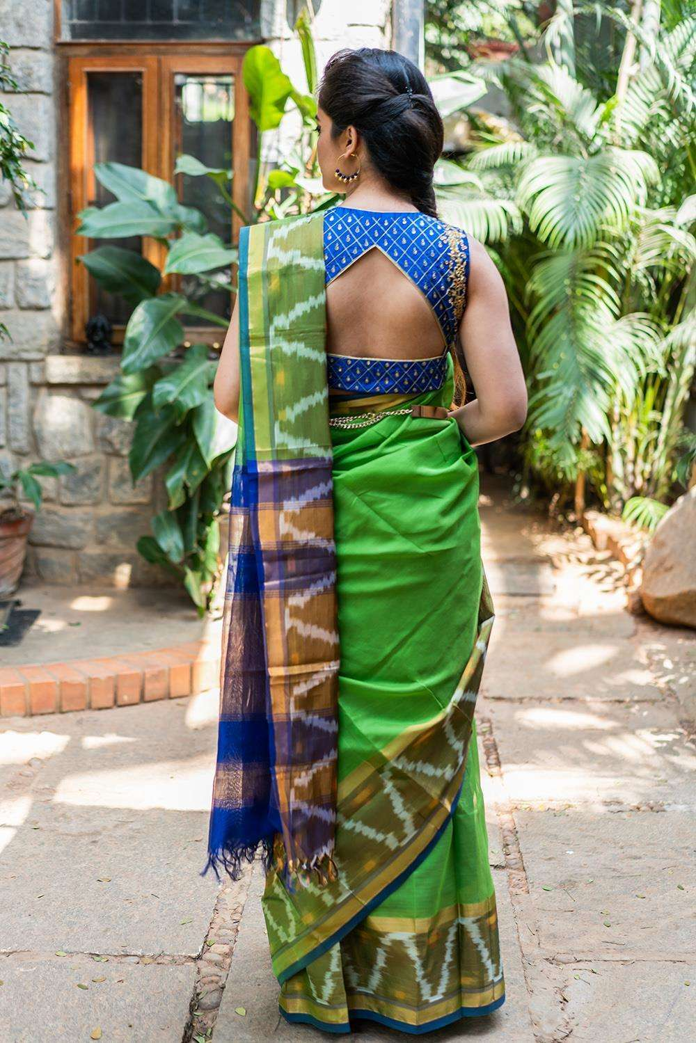 Akkadevi - Leaf green silk cotton saree with ikat border and blue edging - House of Blouse