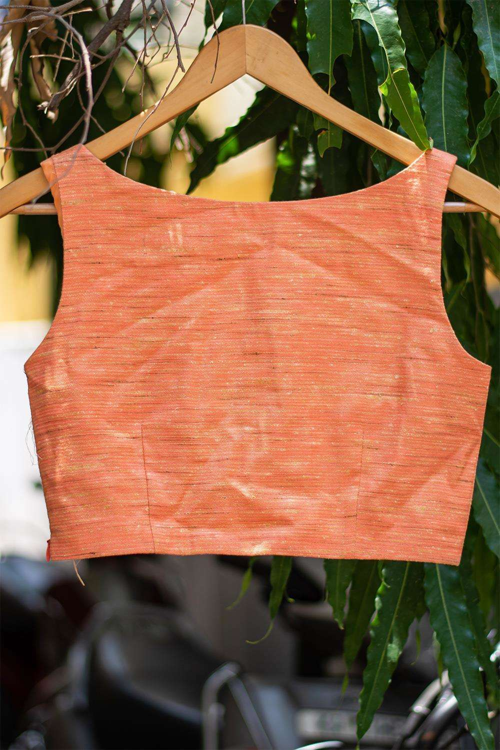 Apricot orange jute tussar boatneck sleeveless blouse with cut out at neck - House of Blouse