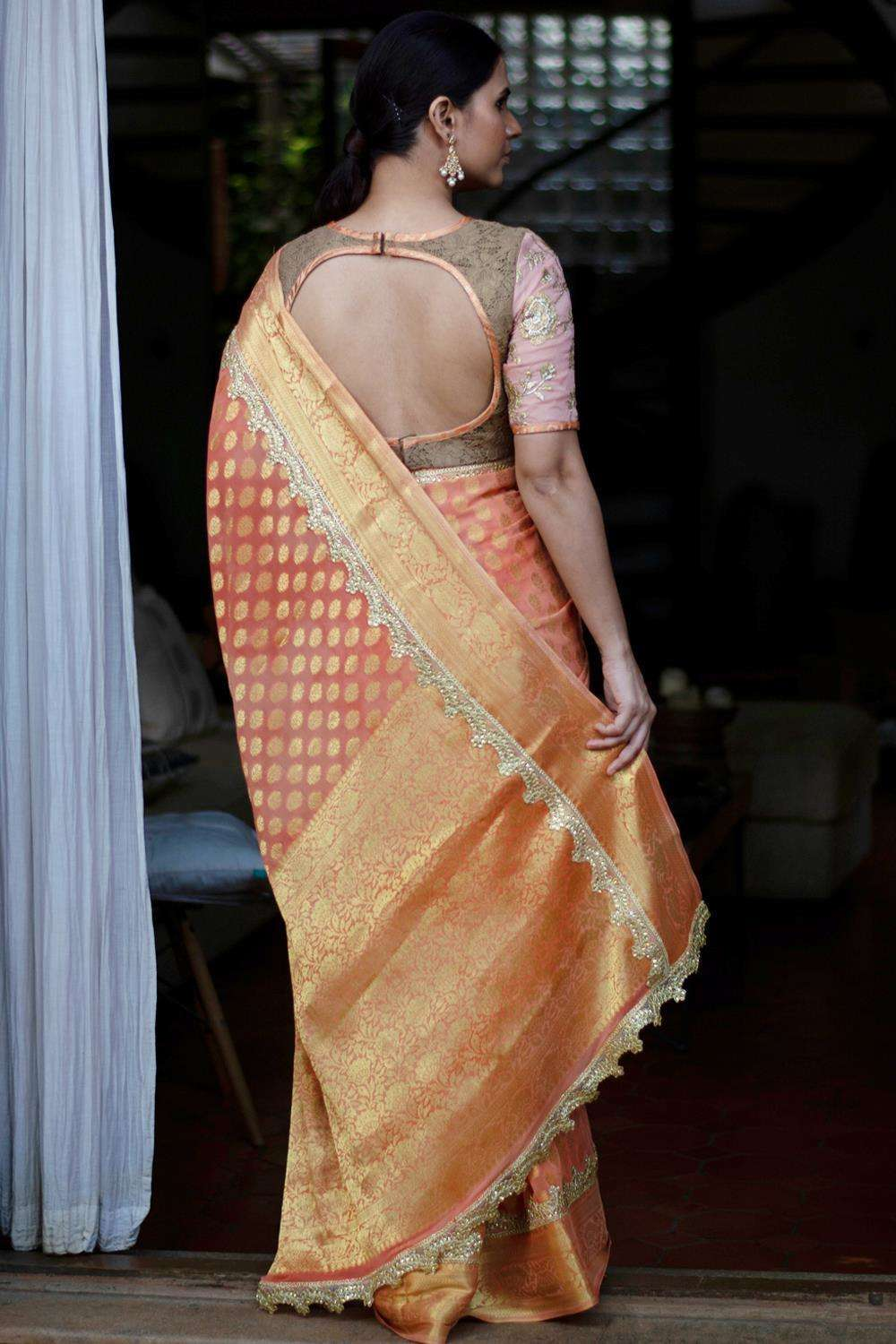 Banarasi chiffon saree in pale orange, with zari buttis and a kundan worked border