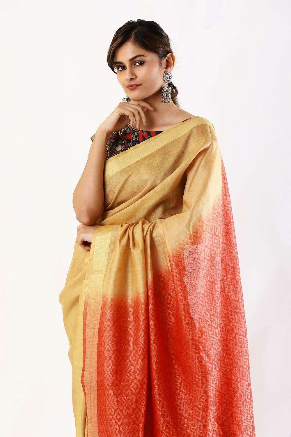 Beige linen saree with red-orange woven Ikat pallu