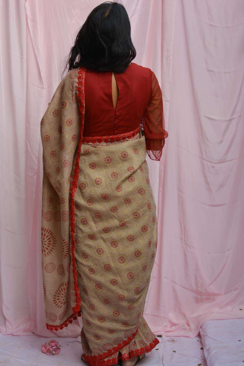 Beige soft linen saree with maroon and gold block print and red lace edging