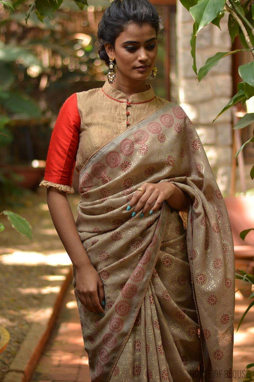 Beige soft linen saree with maroon and gold block print, tissue edging and gold bead edging