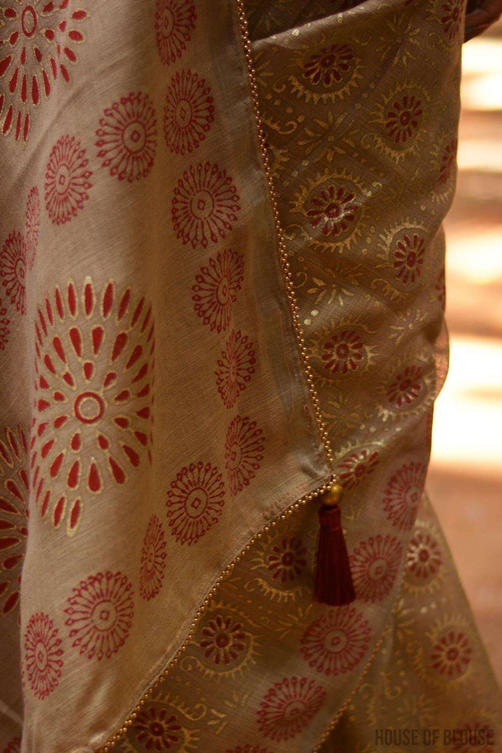 Beige soft linen saree with maroon and gold block print, tissue edging and gold bead edging - House of Blouse