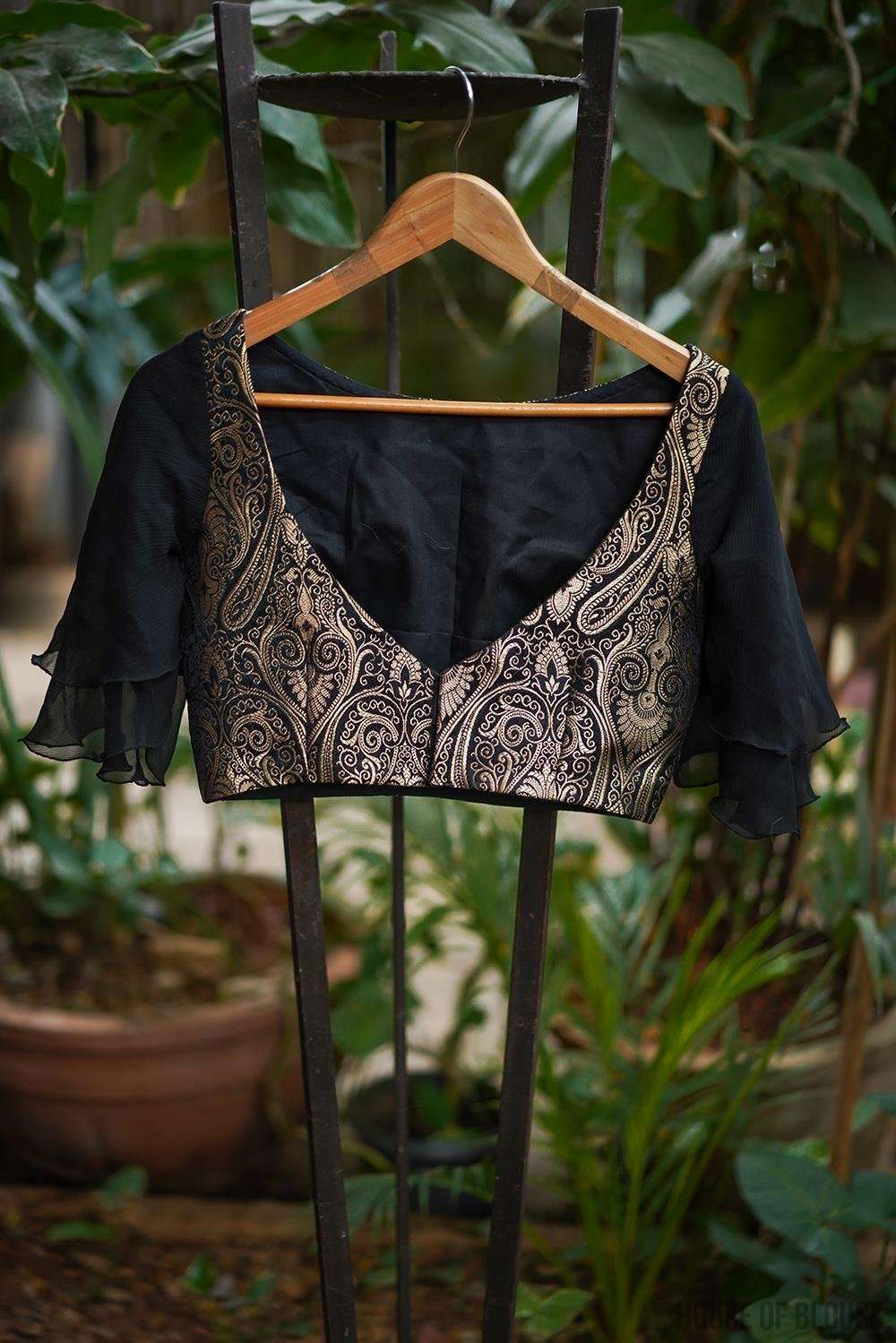Black and gold brocade boatneck blouse with chiffon bell sleeves