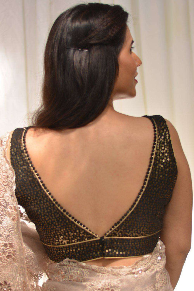 Black and gold sequin embroidered georgette V neck blouse with pompom edging