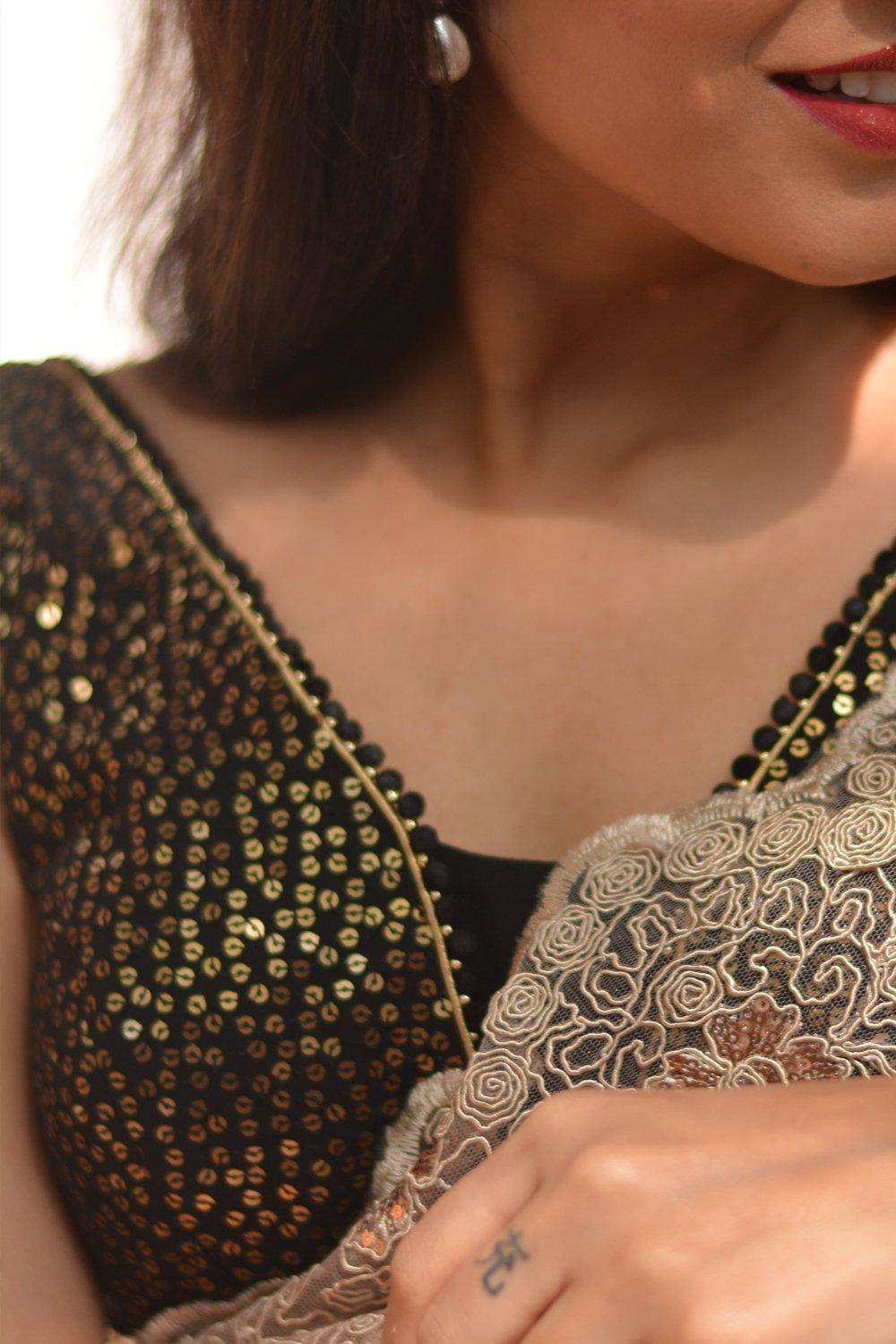 Black and gold sequin embroidered georgette V neck blouse with pompom edging - House of Blouse