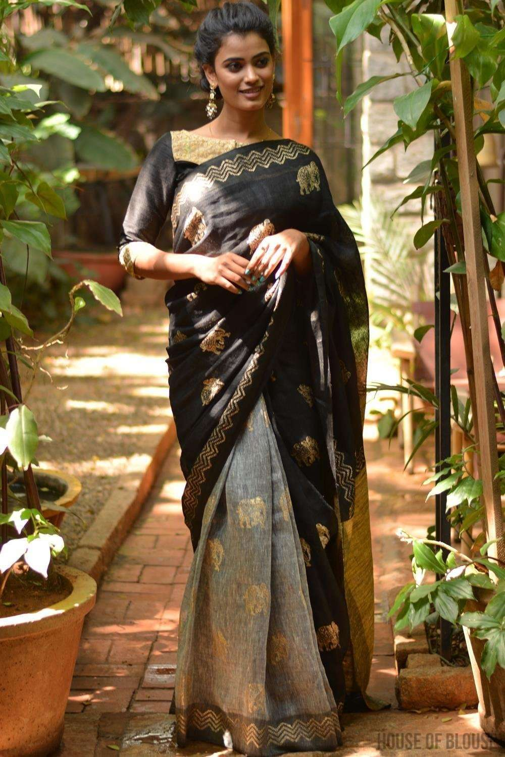 Black and grey half and half linen saree with gold block print and Gitcha pallu