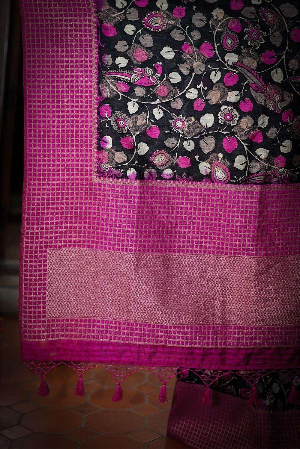 Black and pink Kalamkari silk cotton saree with zari motifs and checked zari border