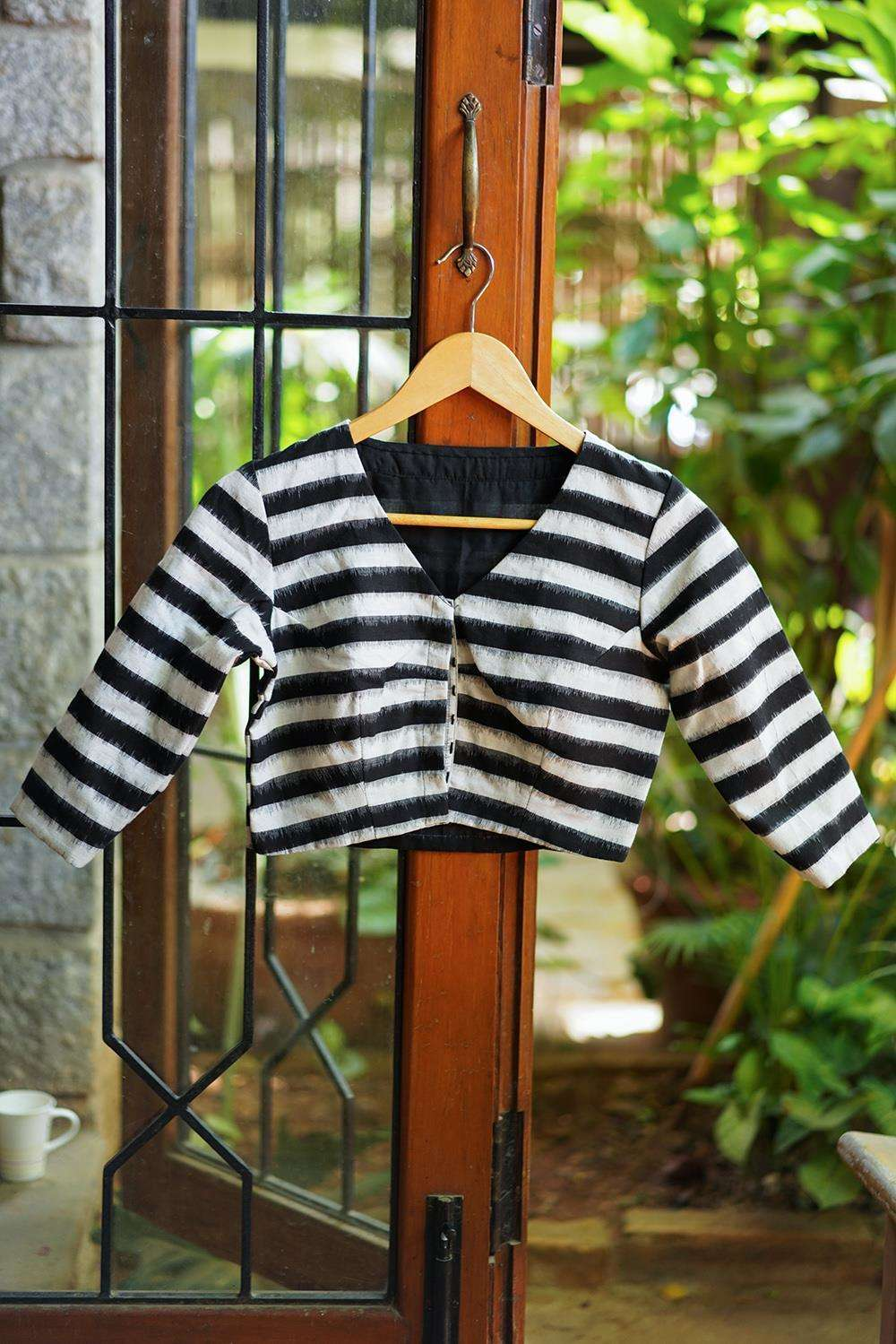 Black and white striped Ikat cotton V neck blouse
