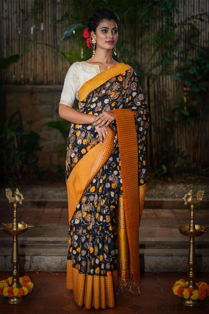 Black and yellow Kalamkari silk cotton saree with zari motifs and checked zari border