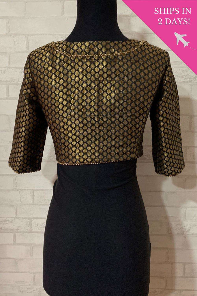 Black brocade blouse with cutout at neck; Size: 34