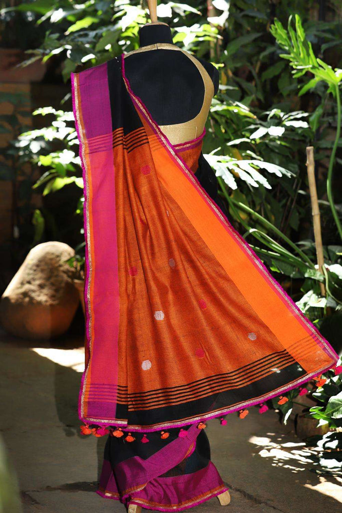 Black linen saree with pink and orange threadwork motifs and pink-gold frill edging - House of Blouse