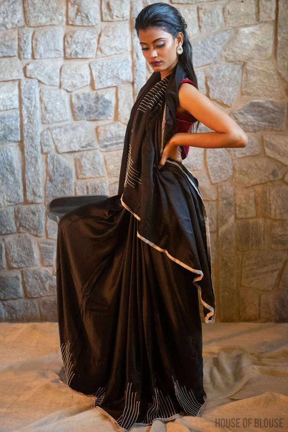 Black pure silk satin saree with silver bead and sequin embroidery and silver tissue edging
