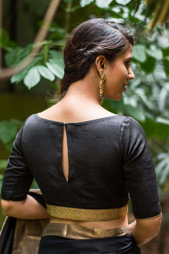 Black raw silk boatneck blouse with gold sequin border - House of Blouse