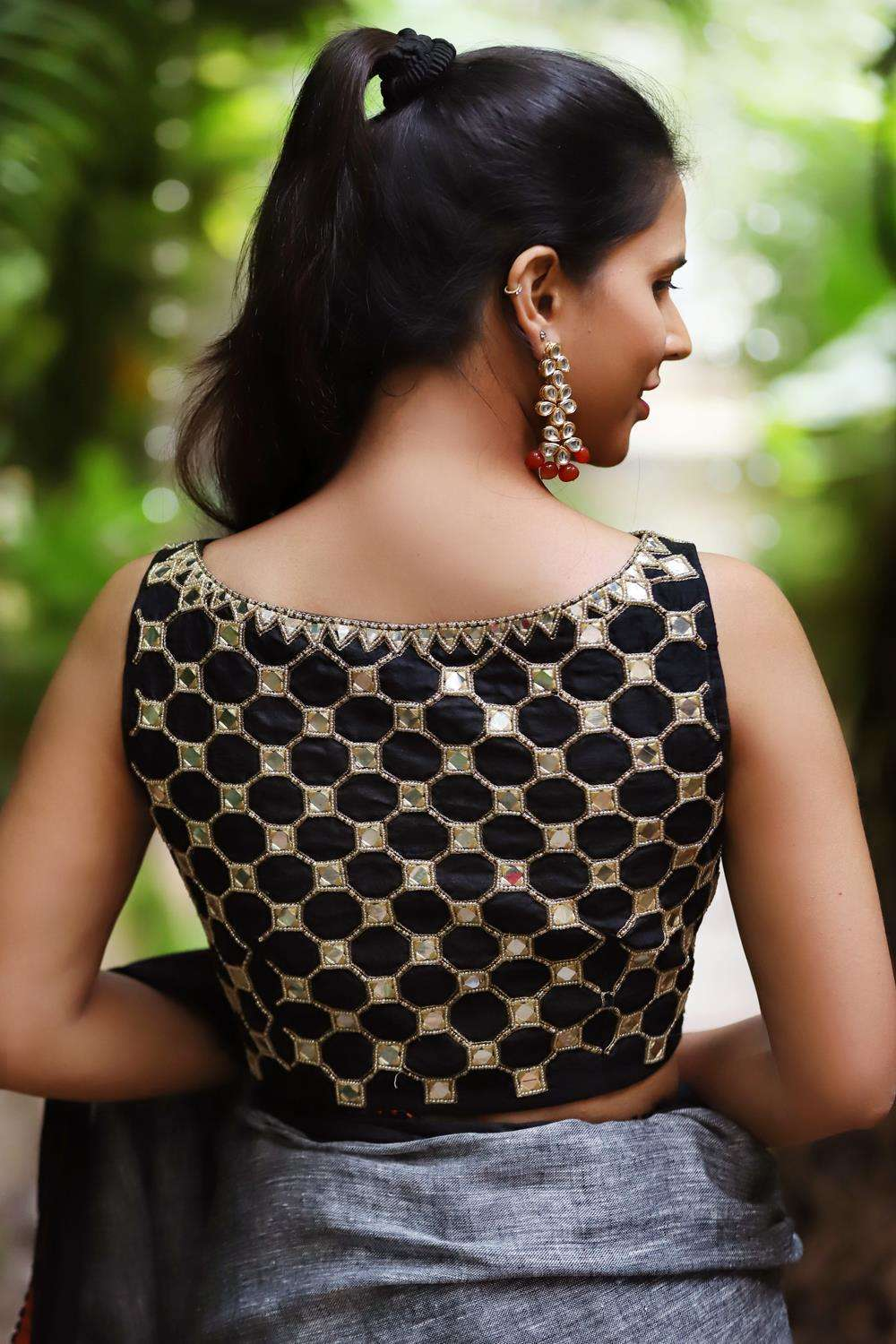 Black raw silk boatneck sleevless blouse with rich mirror and bead embroidery - House of Blouse
