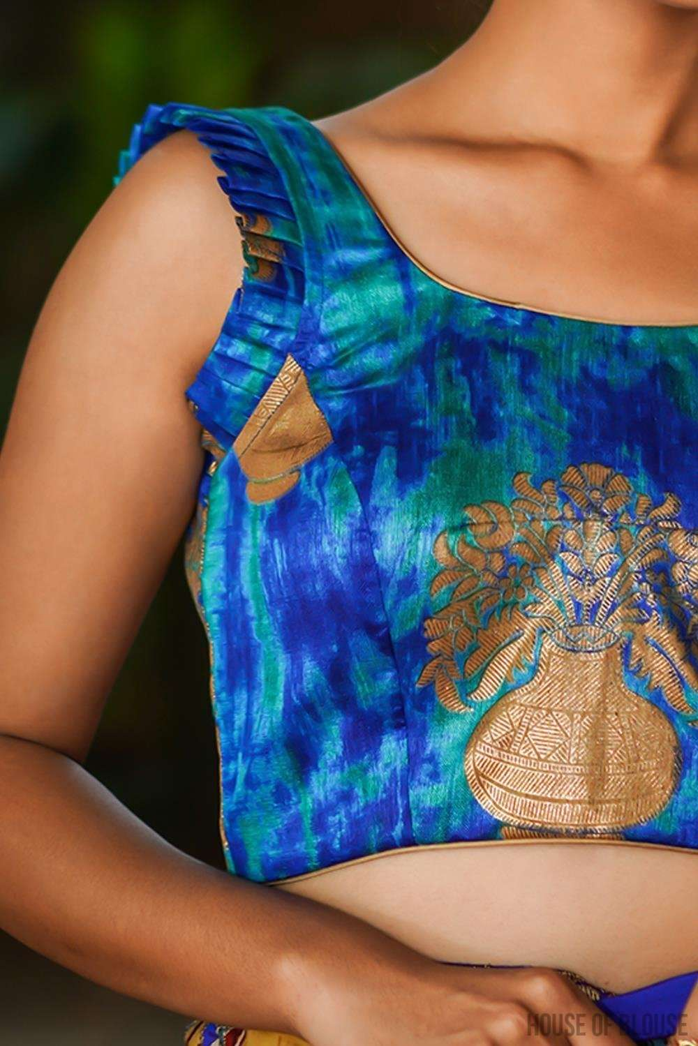 Blue shibori shaded raw silk sleeveless blouse with pleated frills on sleeves