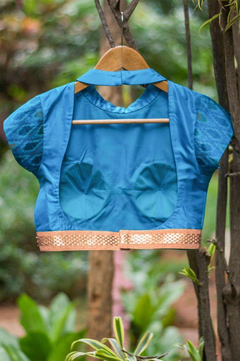 Blue silk high neck blouse with back detailing