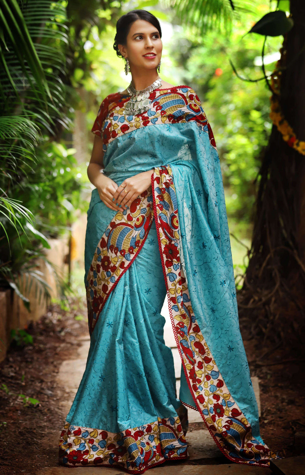 Blue thread work silk saree with handpainted kalamkari border