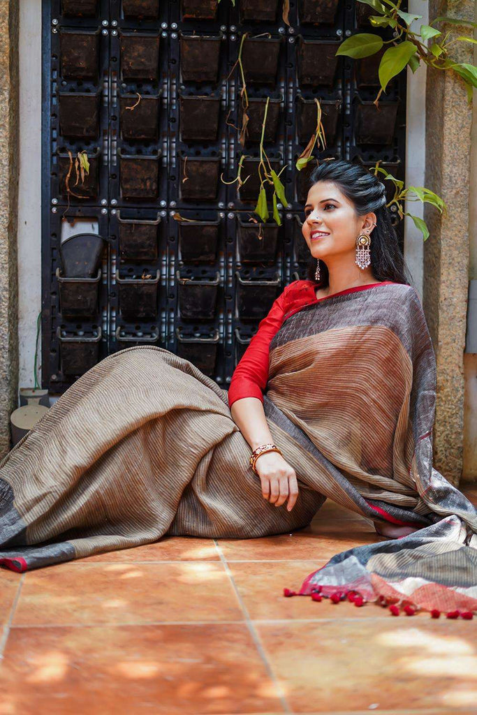 Brown striped handloom linen saree with silvery black tissue border and red edging