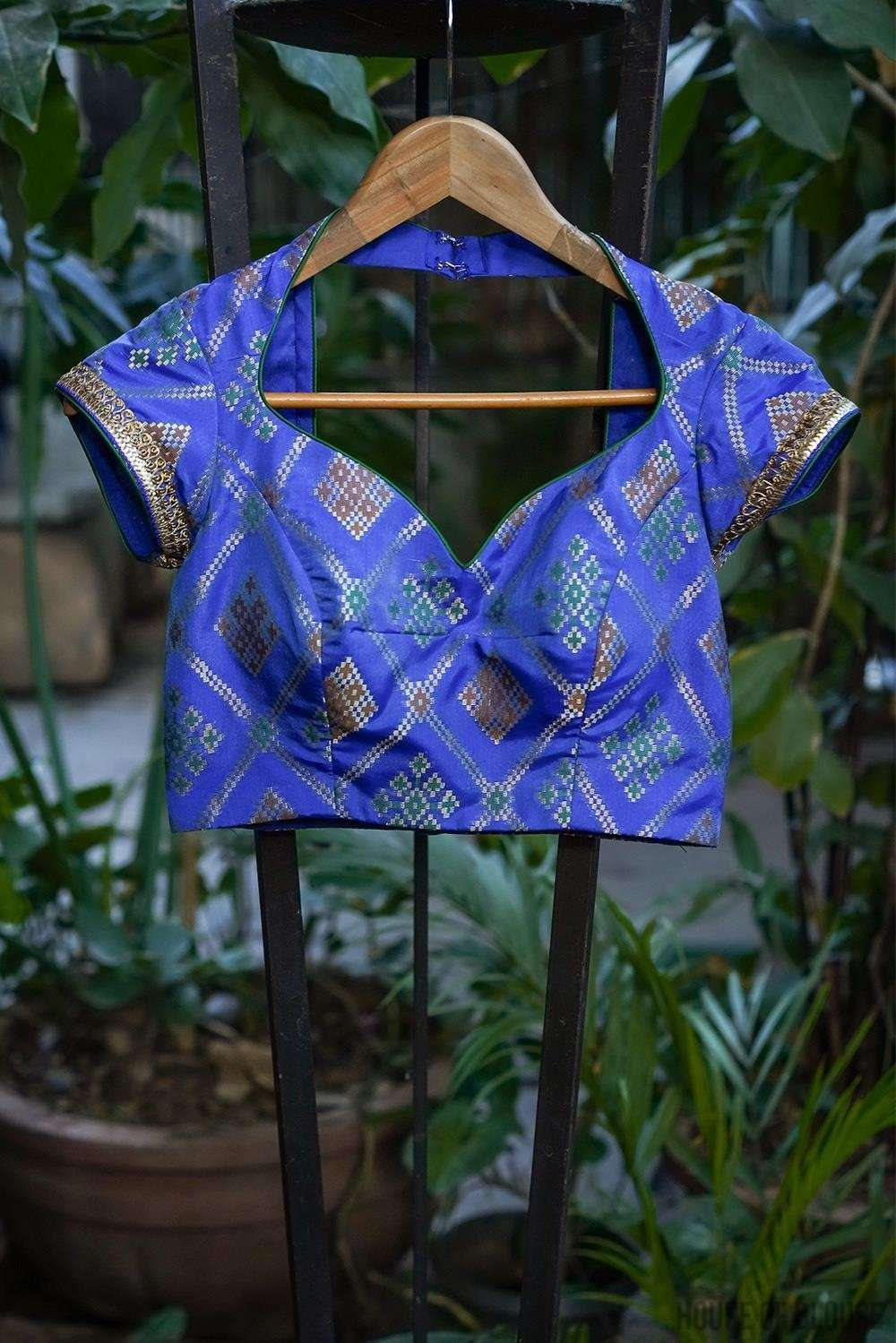 Cobalt blue multicolour brocade sweetheart neck blouse with border detailing