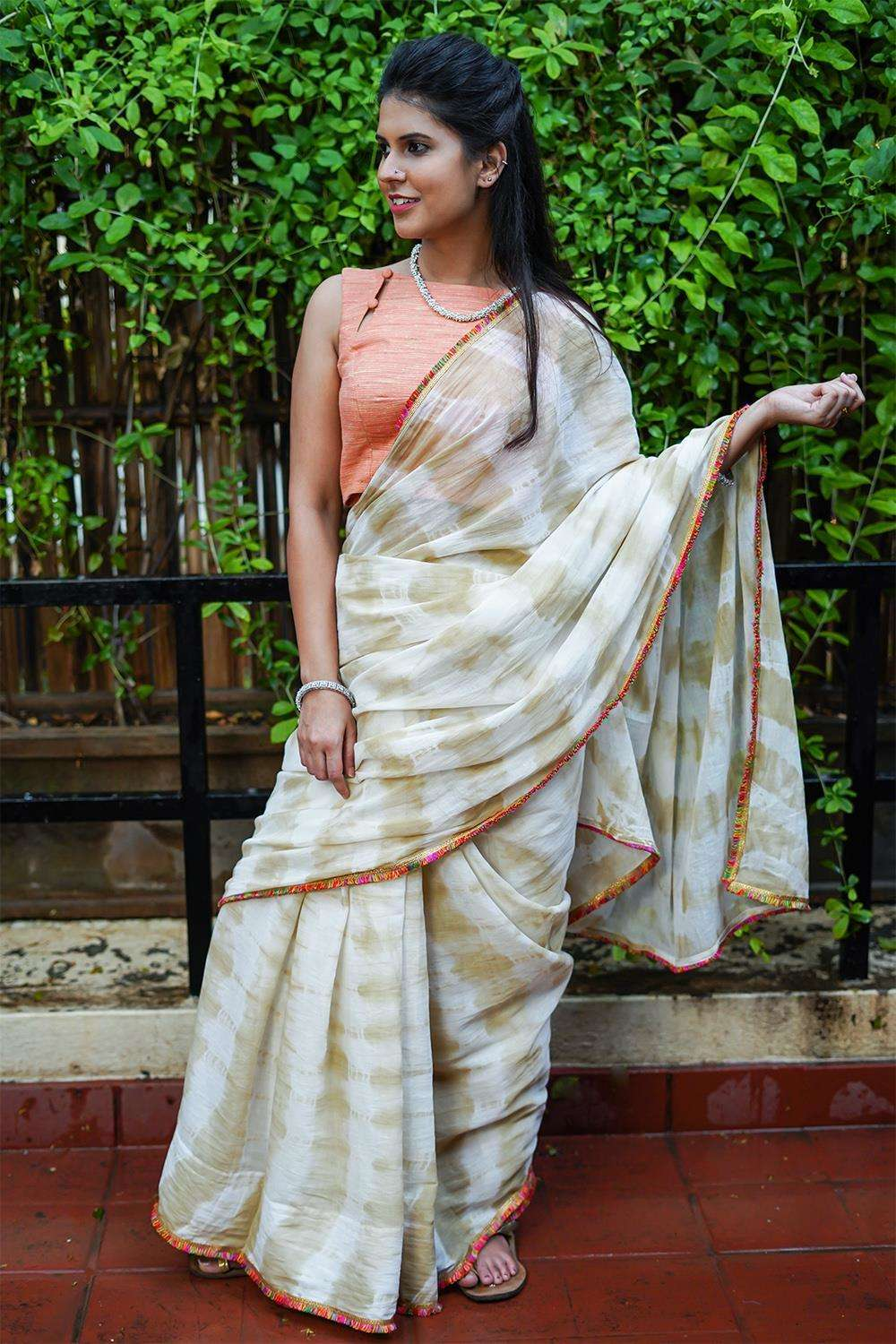 Cream and brown shibori shaded mul cotton saree with multicolour frill edging