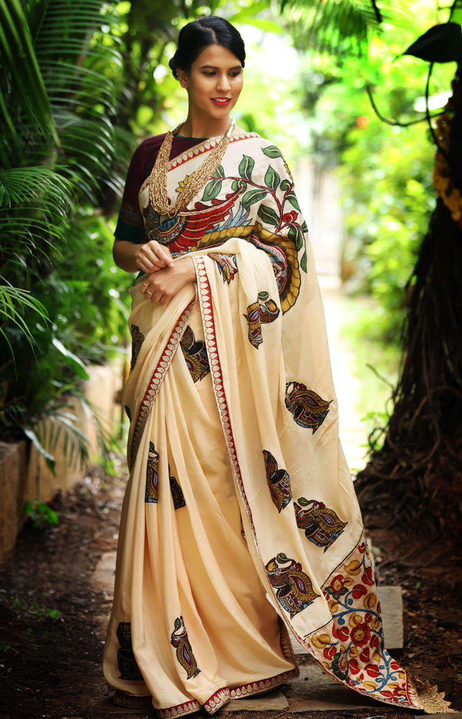 Cream pure crepe saree with handpainted Kalamkari appliqués