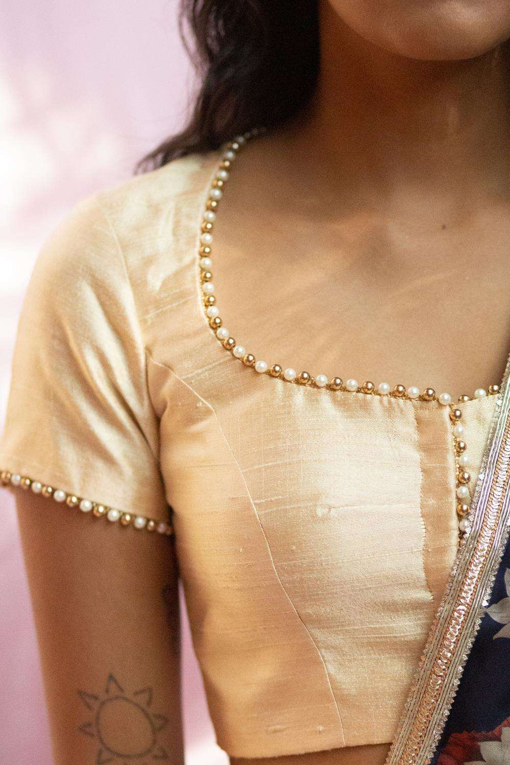 Cream raw silk pot neck blouse with bead detailing
