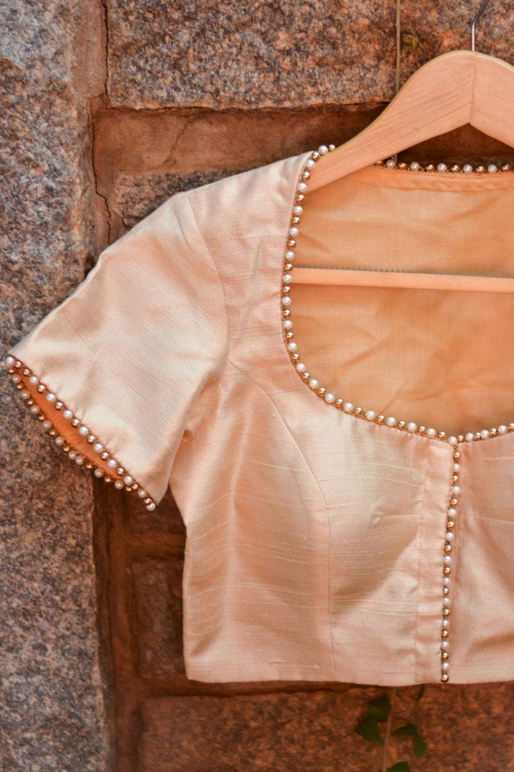 Cream raw silk pot neck blouse with bead detailing - House of Blouse