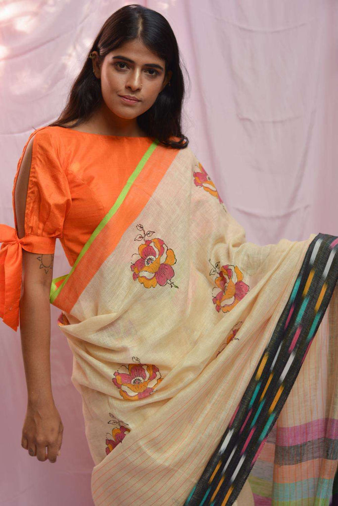 Cream striped linen saree with block print and multicolour Ikat border