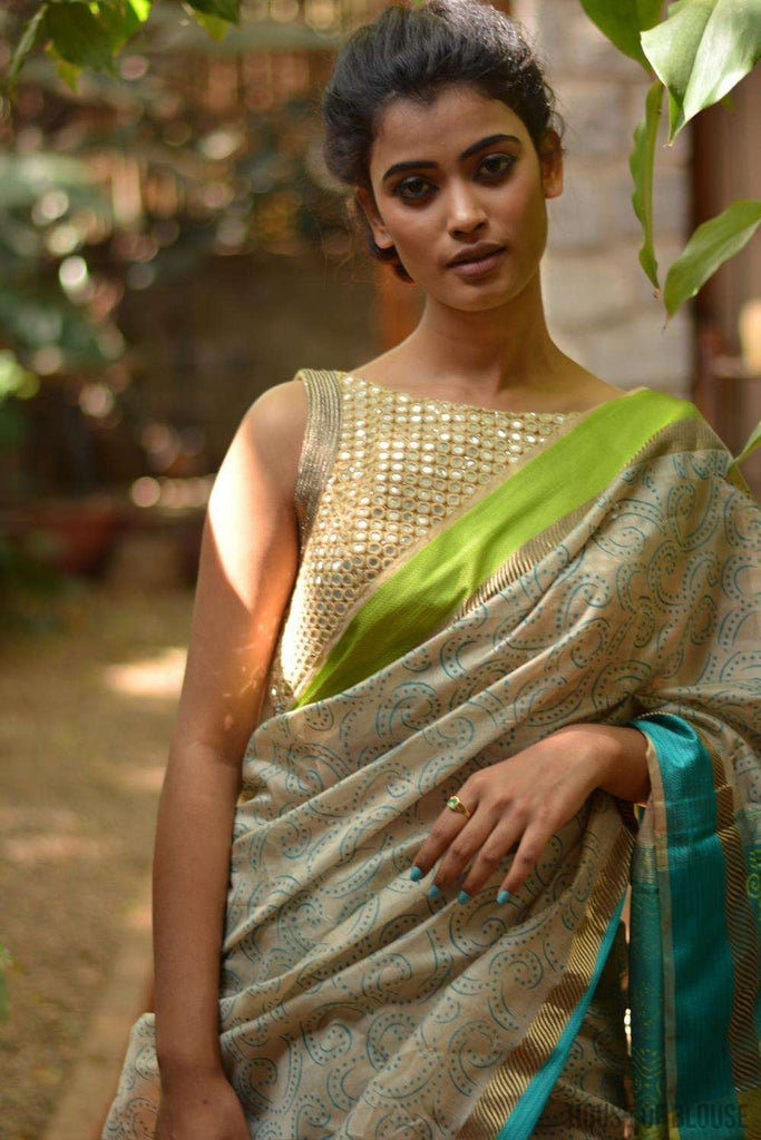 Dark beige Maheshwari silk saree with blue and gold block print, zari and ganga jamuna border