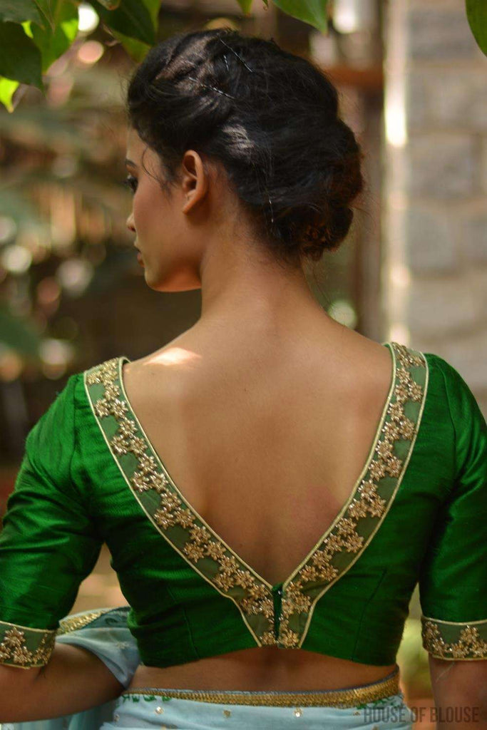 Emerald green raw silk V-neck blouse with gold floral border