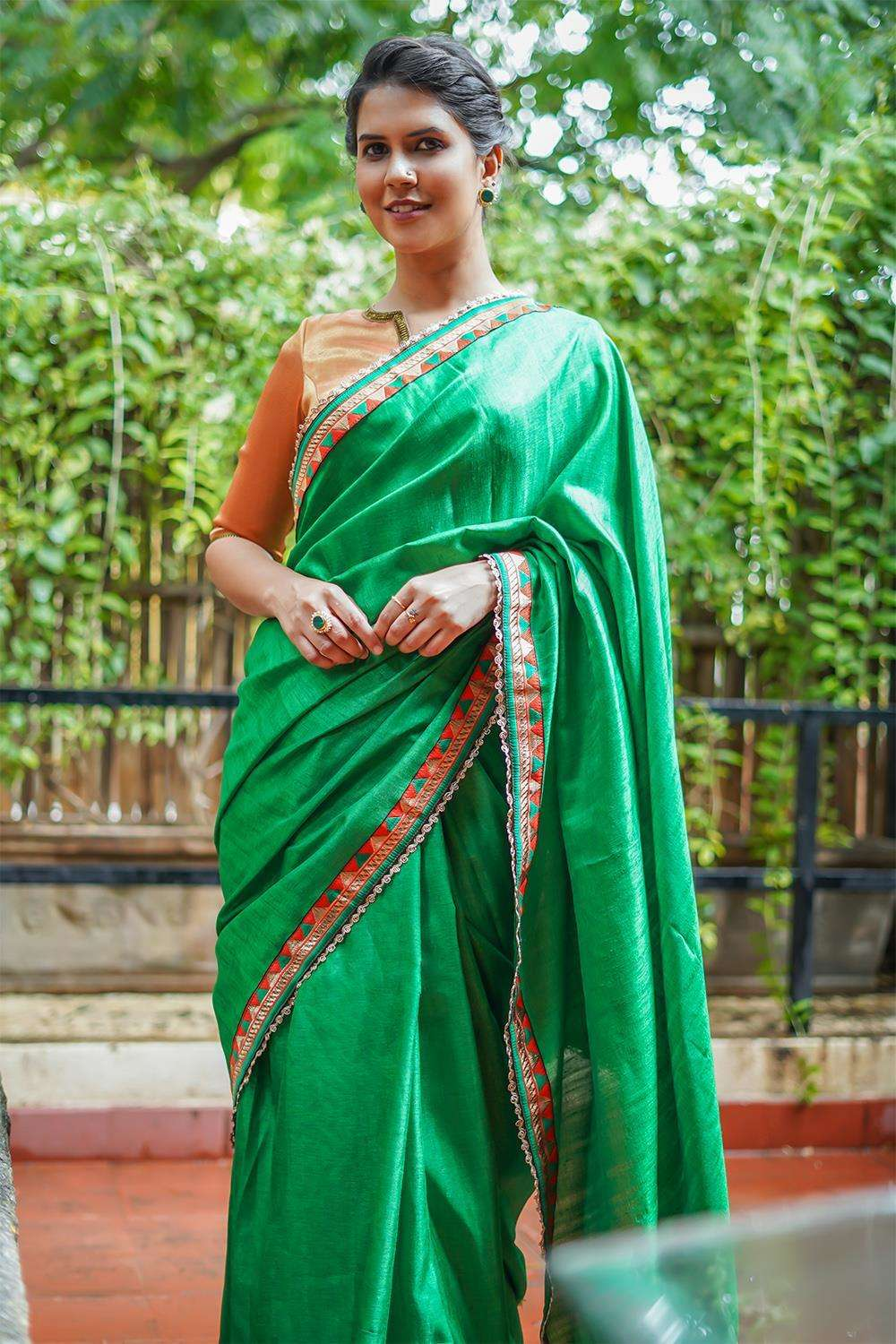 Fern green semi matka silk saree with orange-green geometric border - House of Blouse
