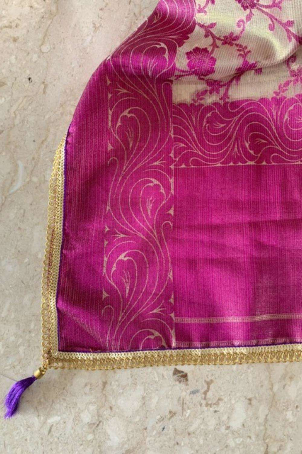 Gold and purple tissue saree with floral weave and gold sequin edging