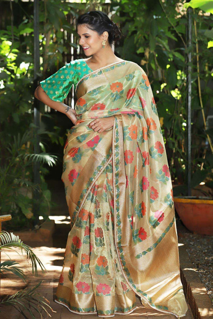 Gold tissue floral saree with zari and pearl border