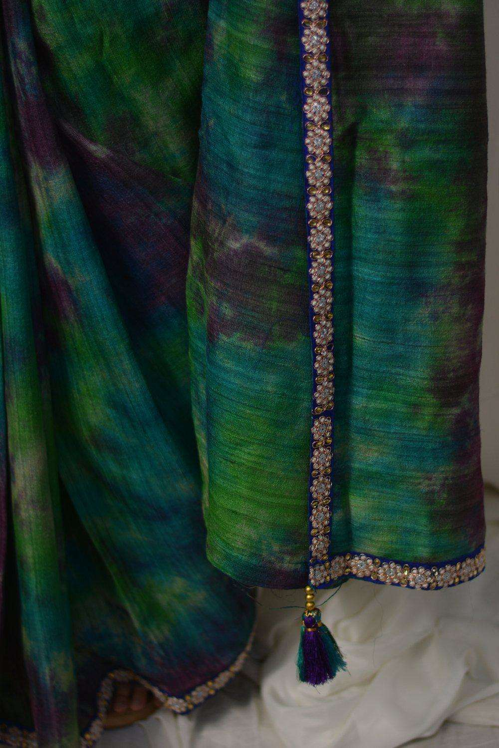 Green, blue and purple shibori shaded jute silk saree with blue embroidered border