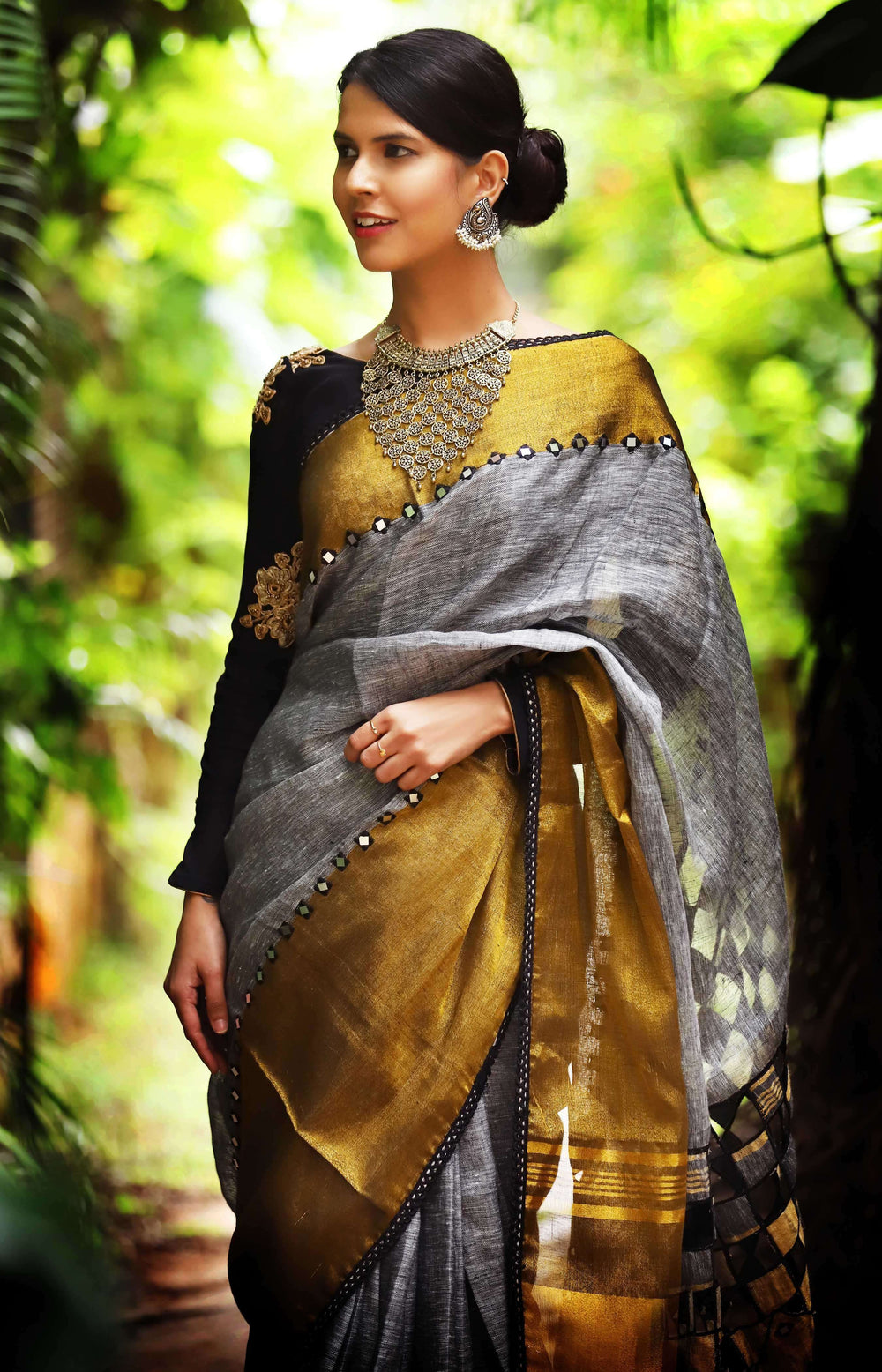 Grey Linen with tissue border with mirror work and cutwork pallu
