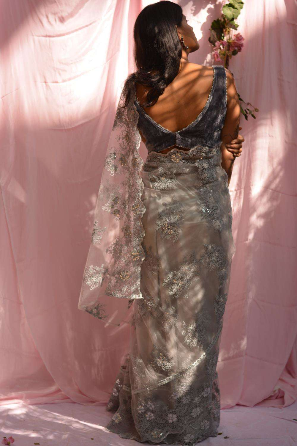 Grey net saree with lacy self-coloured threadwork and silver border