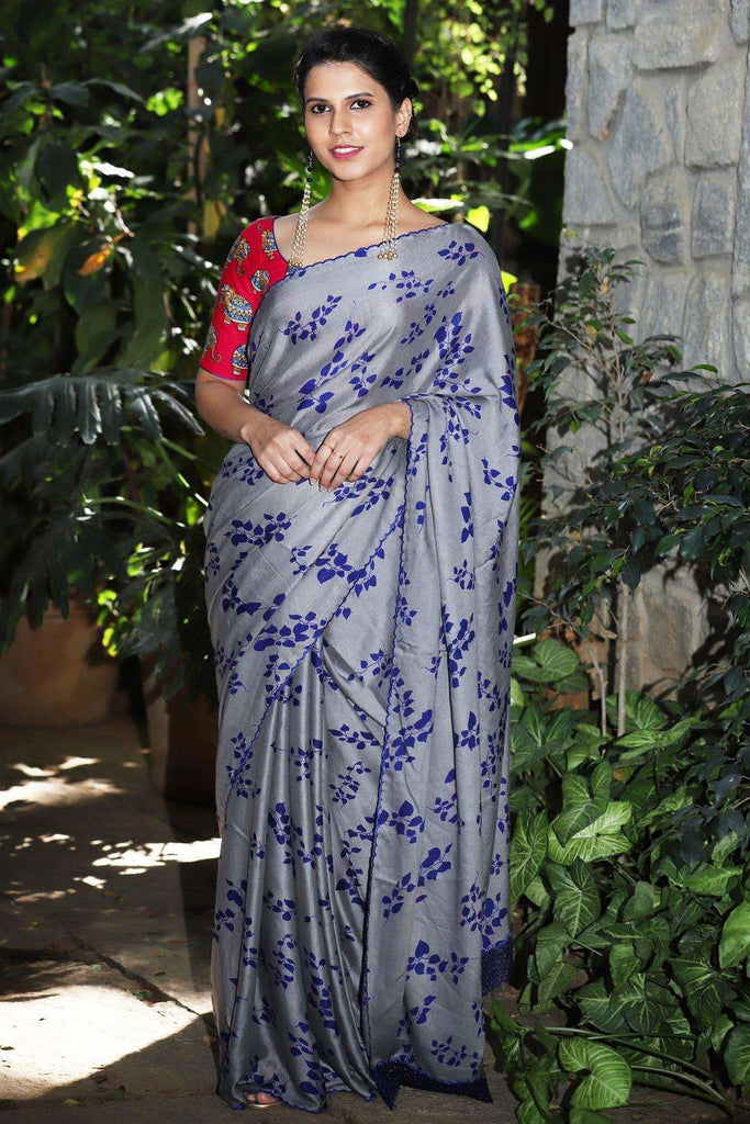 Grey rayon saree with royal blue leaf print and embroidered scallop edging
