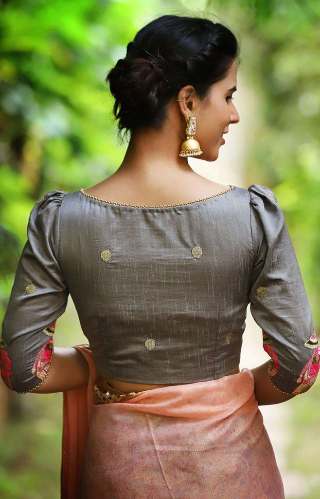 Grey semi silk boatneck blouse with gold bhuttis and embroidered elephants